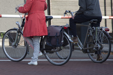 waiting with bicycle