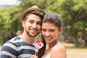 Cute couple sharing a lollipop