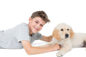 Boy with dog over white background