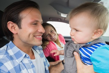 Parents and baby on a drive