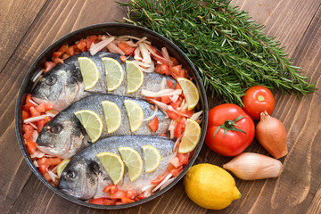 Sea fish with vegetables before cooking.