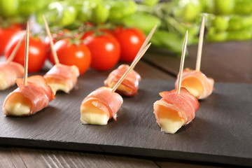 Mini mozzarella wrapped in schwarzwald ham and baked