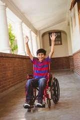 Boy in wheelchair in school corridor
