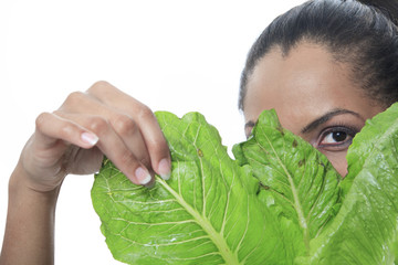 A mulatto person look through a salad