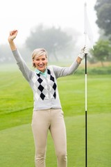 Lady golfer cheering