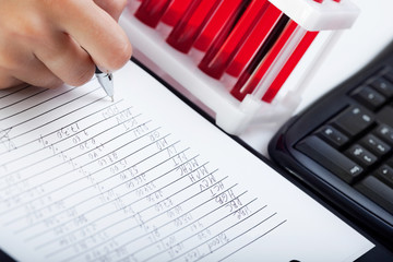Doctor's medical notes and blood samples