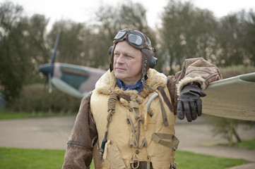 WW2 RAF Fighter Pilot With Spitfire Aircraft