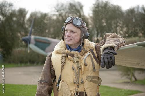 Leinwanddruck Bild WW2 RAF Fighter Pilot With Spitfire Aircraft