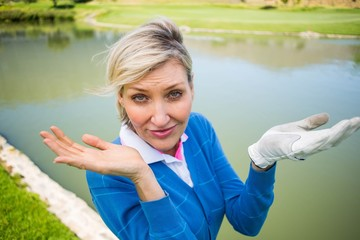 Worried female golfer looking for golf ball