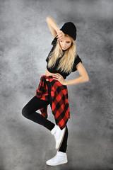Hip hop dancer portrait on grunge background