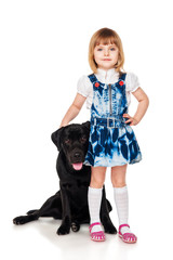 Beautiful little girl  with a black Labrador