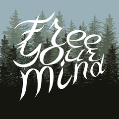 White lettering free your mind on fir tree card