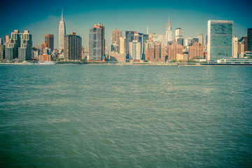 Vintage toned image of New York City skyline across river