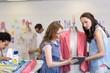 Fashion designers using digital tablet
