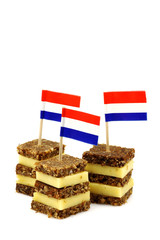 traditional layered rye bread and cheese snacks with Dutch  flag