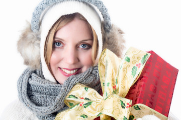 Model Released. Young Woman Carrying Christmas Present