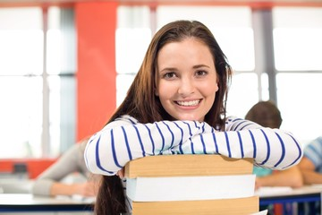 Smiling female student in classroom
