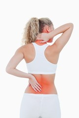 Blonde woman showing pain in her back and in her neck