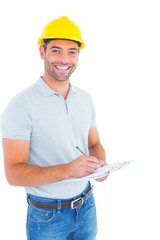 Portrait of smiling male supervisor writing on clipboard