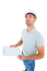 Manual worker looking up while holding clipboard
