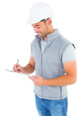 Smiling manual worker writing on clipboard