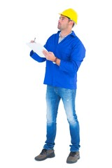 Manual worker looking up while writing on clipboard