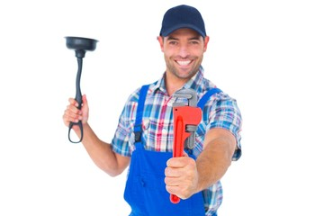 Handyman holding plunger and wrench on white background