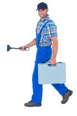 Happy plumber with plunger and toolbox walking