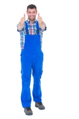 Happy handyman in coveralls gesturing thumbs up