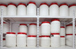 white chemical plastic barrels on shelves in storehouse - 78789068
