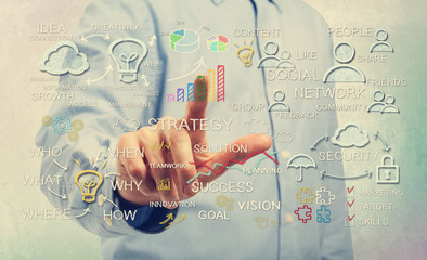 Man pointing at business strategy concepts