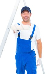 Handyman using paint roller on white background