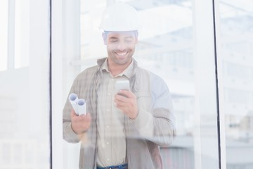 Architect using mobile phone in office