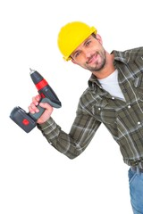 Smiling repairman with drill machine