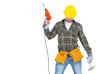 Repairman holding hammer and drill machine