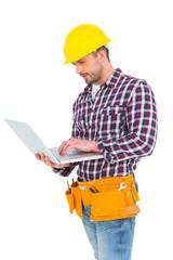 Handyman using laptop