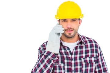 Repairman talking on mobile phone