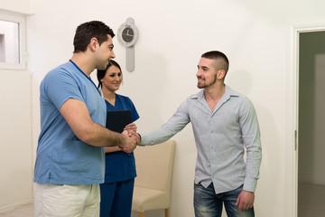 Dentist Congratulate Patient For A Successful Operation