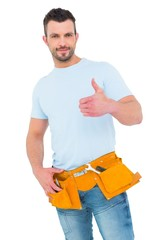Handyman wearing tool belt with thumbs up