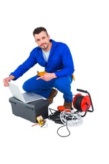 Electrician using laptop