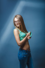 European-looking girl of twenty years in glasses bared stomach o