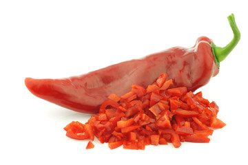fresh red sweet pepper (capsicum) and  cut pieces on a white bac