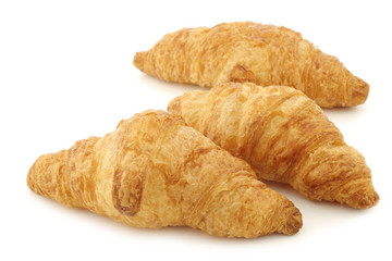 freshly baked croissants on a white background