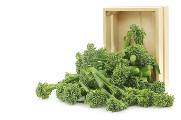 small form of broccoli, called bimi, in a wooden box on a white