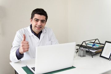 Portrait Of Male Doctor With Netbook