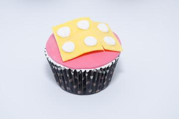 Creative cupcake with pills made of fondant