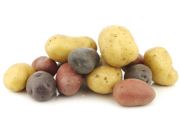 yellow, red and purple potatoes on a white background