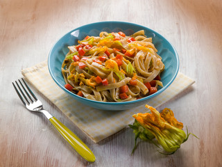 tagliatelle with zucchinis flowers and capsicum