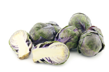 cut purple brussel sprouts on a white background