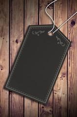 Composite image of elegant dark grey tag